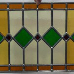 Raamhanger met glas in lood blauw oranje geel 375x300mm