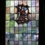 Brandschildering in glas in lood raam