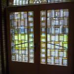 Rijk gedecoreerd glas in lood raam