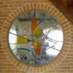 rond venster met glas in lood