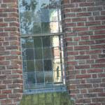 Blank glas in lood in monumentale kerk