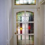 gekleurd glas in lood vervaardigd voor voordeurpui